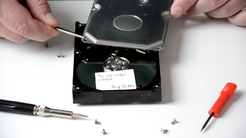 When the technician opens a hard drive disk, we see short note from the big brother you are under control