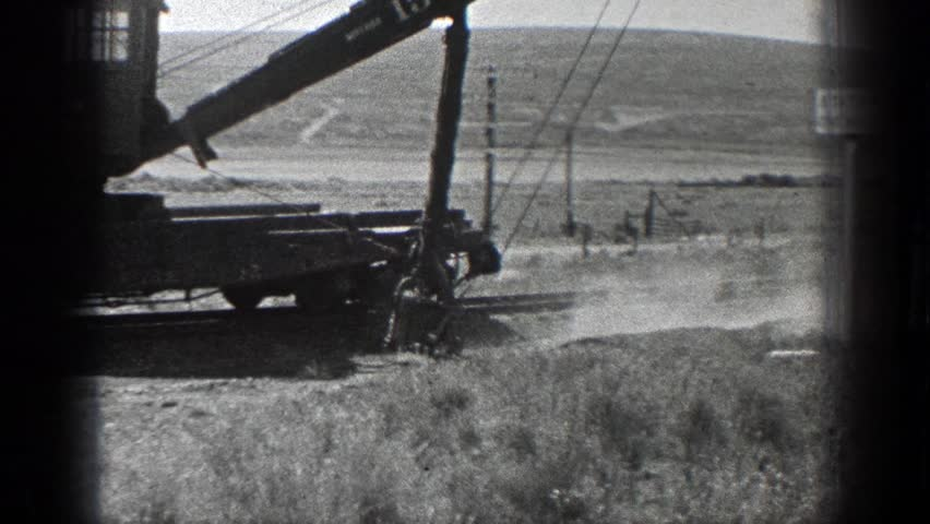 CALIFORNIA 1936: an earth mover is working in a vast arid land with grasses | Shutterstock HD Video #21503683