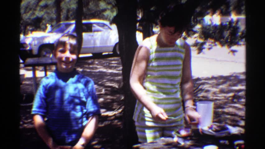 ARIZONA 1969: preoccupied woman with two smiling boys at picnic table by parking lot #21508843