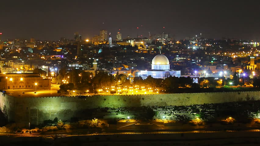 Skyline of Jerusalem Israel Dome of the Rock at night time lapse pan