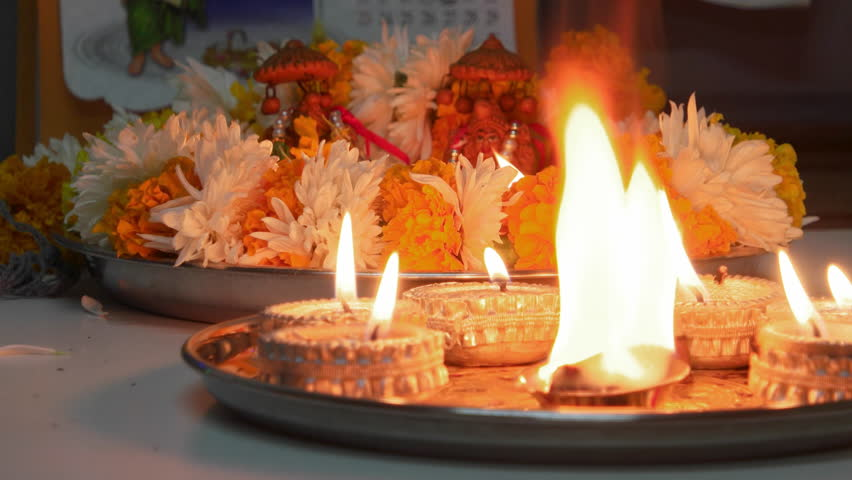 Religious prayer and burning diyas and marigold flower for the Hindu festival