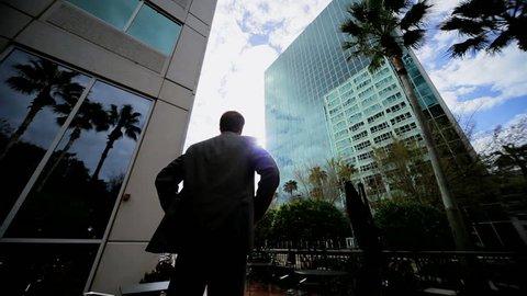 Male executive feeling career success satisfaction