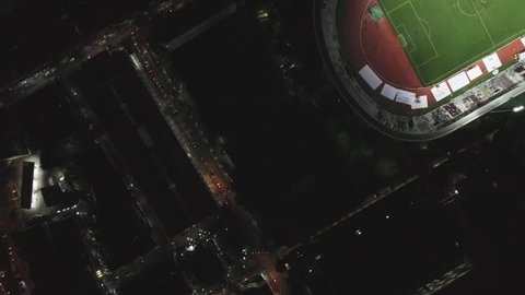 Aerial View, Bird eye view of Football Stadium at Night in the central city.