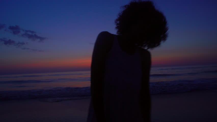 Silhouette coast lifestyle sea recreation leisure travel resort young ethnic girl romantic Summer holiday dawn sunrise #21572803