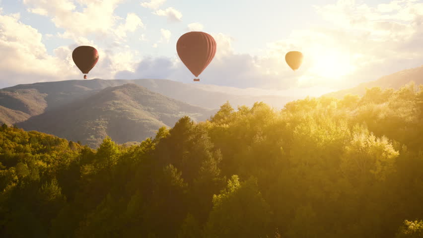 Colourful Red Blue Yellow Colours Hot Air Baloons Aerial Drone Flight Over Beautiful Autumn Forrest at Sunet Mountains Beautiful Landscape Background Sunny Vacation Travel Destination Concept