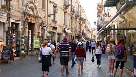 September 2016 Taormina in Sicily, italy: may tourists shopping in the main street corso umberto of taormina