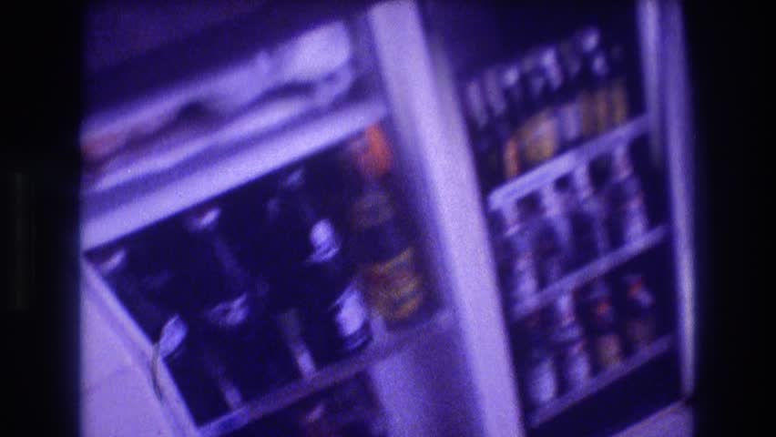 ACAPULCO MEXICO 1982: filled bottles are kept inside a white colored refrigerator