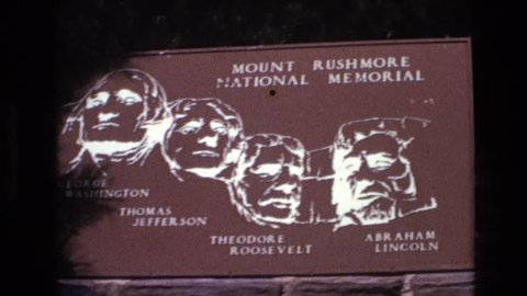SOUTH DAKOTA 1974: sign in with white paint of mount rushmore national memorial