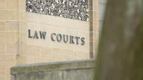 Law Courts sign on the exterior of a crown court building, UK