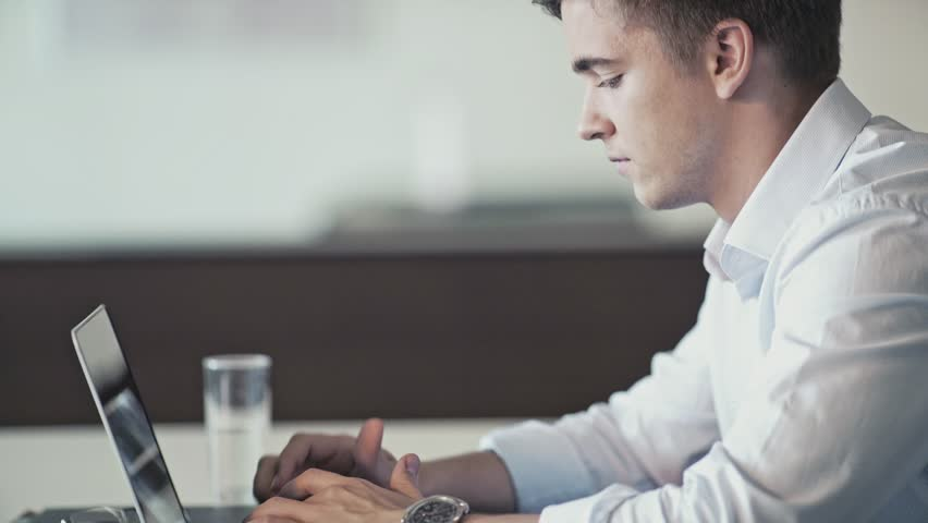 Young man with laptop in office | Shutterstock HD Video #21651601