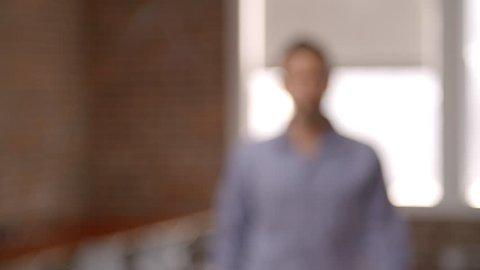 Portrait Of Businessman In Office Shot In Slow Motion