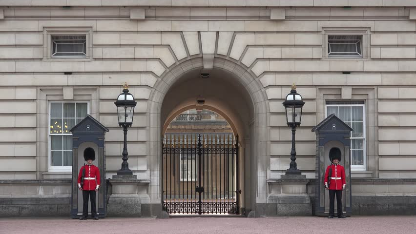 LONDON, AUGUST 22, 2016 4K London Buckingham Palace, Armed English Guard Marching and Guarding