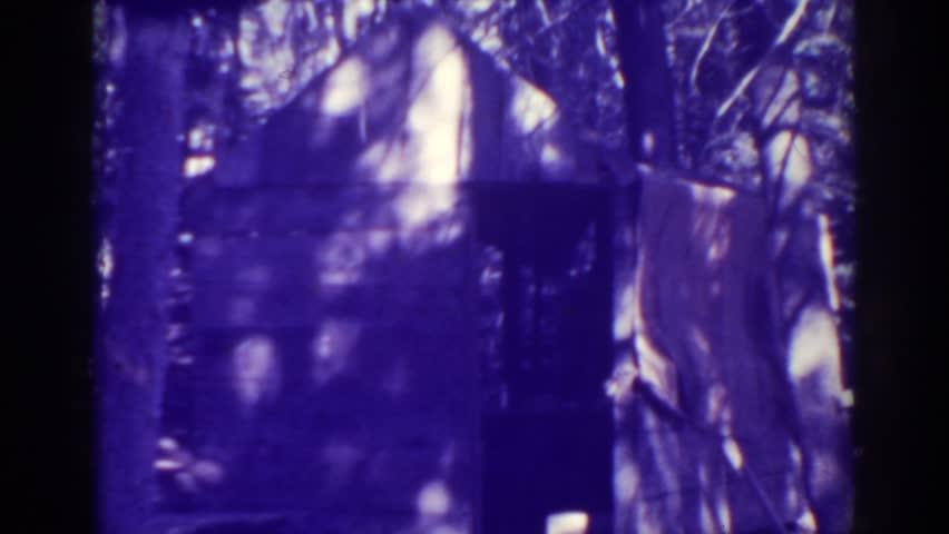 BUCKS LAKE CALIFORNIA 1938: shade filled area dark area with building | Shutterstock HD Video #21720343
