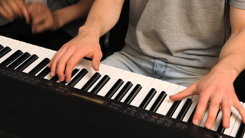 a student learning how to playing piano