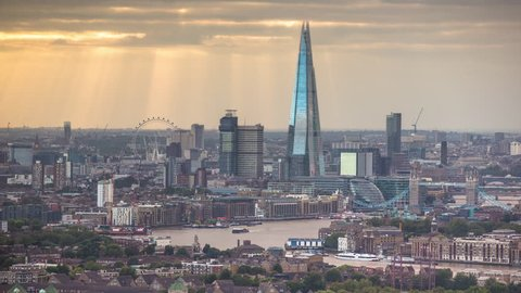 LONDON - AUGUST 2016 : Timelapse of the city of london skyscapers and Shard shot zoomed in from a high vantage point far away. amazing sunrays are captured during this shot, London. AUGUST 09, 2016
