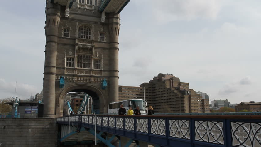 LONDON APRIL 14 2012: Pedestrians and traffic crossing Tower Bridge London April 14th 2012