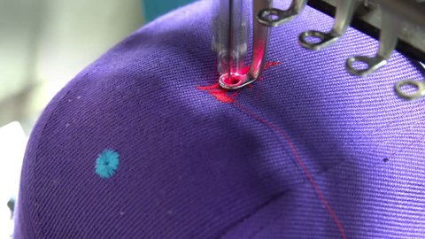 Hat Embroidery machine. Sewing machine embroider signs. Sewing needle stitching