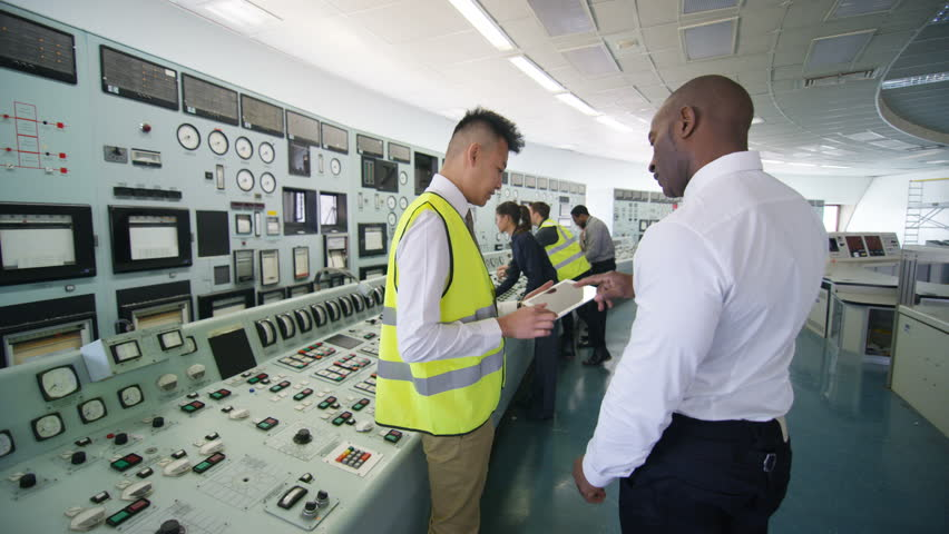 4K Mixed ethnicity team of engineers working in power station control room (UK-Oct 2016)   Shutterstock HD Video #21807043