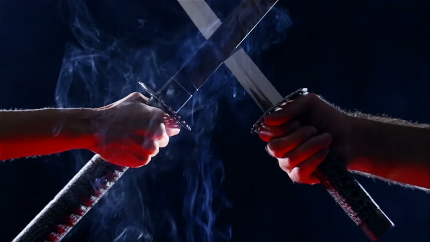 Japanese samurai warriors fighting with swords. Sword battle. Two Japanese katana sword. Blade close-up on a dark background with blue light filter with incense smoke. Steel tempering