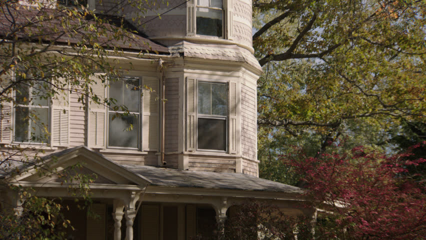 Day turret window then tilt upstairs window turret, left front beige wood clapboard house , wrap around porch, bay windows, autumn, fall trees (Oct 2012)