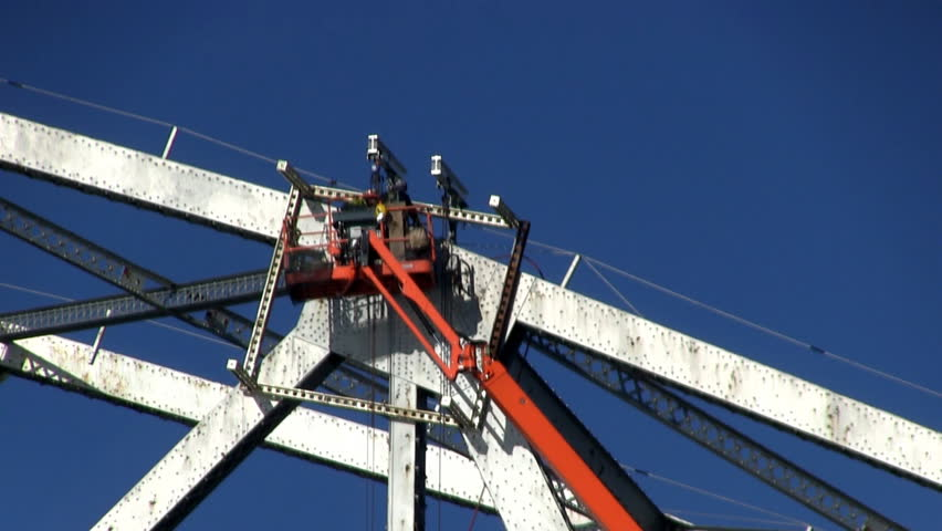 Bridge workers make repairs to Sagamore bridge on cape cod in early spring.  Sounds of distant equipment and birds
