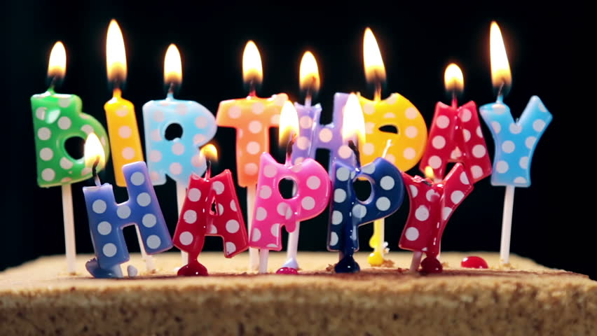 Coloured Happy Birthday Candles Burn And Wax Drips Stock