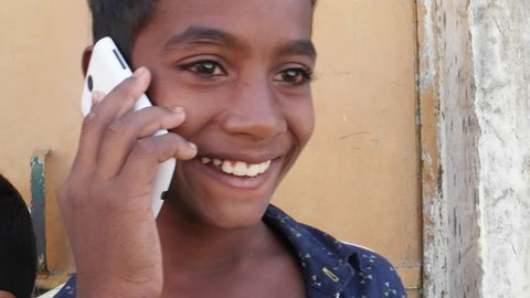 Indian kids talking on cell phone mobile, all excited and happy