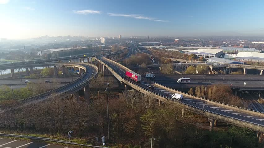 Rising aerial shot of Spaghetti junction and Birmingham city centre.