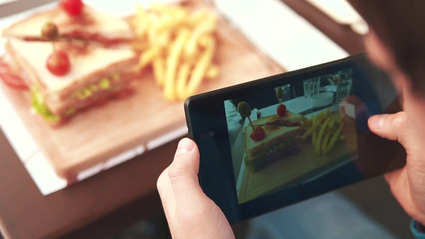 Woman photographing food by phone | Shutterstock HD Video #21905503