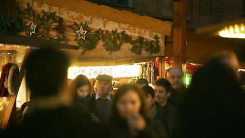 STRASBOURG, FRANCE - CIRCA 2016: Market stall preparing traditional mulled wine from organic ingredients at Christmas Market waiting for customers