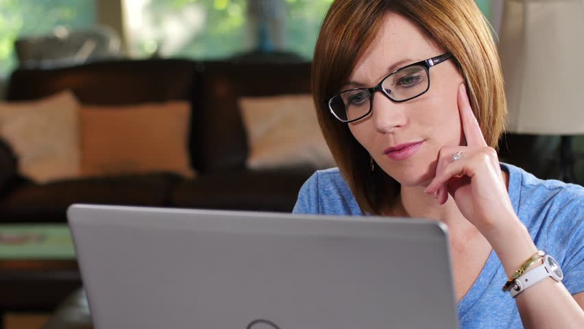 Woman has a light bulb moment while working on laptop