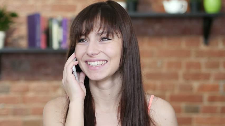 Beautiful Woman Talking On Smartphone, Indoor | Shutterstock HD Video #21985933