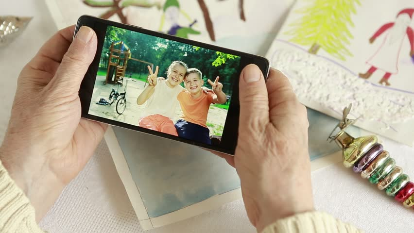 Grandma looks grandchildren photos on your phone  | Shutterstock HD Video #21987211