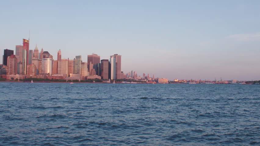 Day late day Across water from New Jersey wide arc left along New York skyline, ferry boat, spring summer | Shutterstock HD Video #21988303