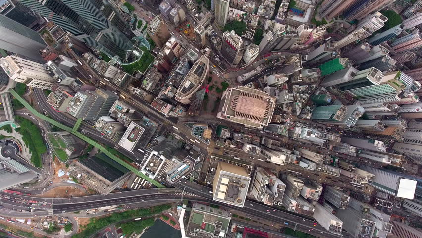 Top view of active traffic on city highways stretching near district of modern architecture buildings and future constructed skyscrapers tower over avenues,video for advertising or filmmaking industry | Shutterstock HD Video #22050637