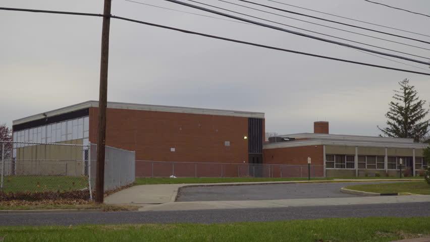 Day school exterior establishing 4k video shot. DX elementary high education building street view lock down