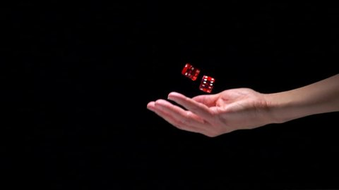 Hand throwing dice in slow motion. Concept film clip of chance, risk and success.