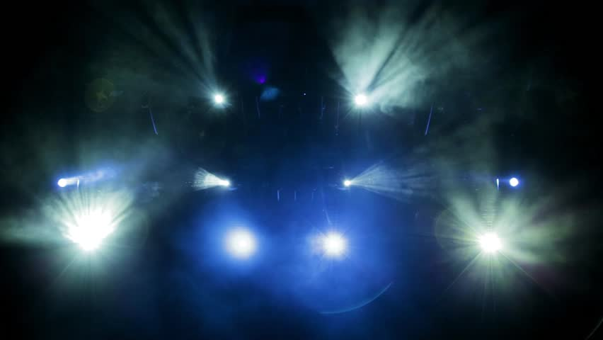 The light of searchlights in smoke on stage of the theatre. Footage, video