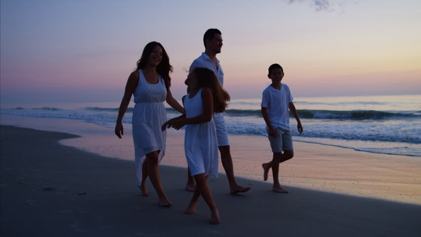 Carefree Spanish parents children together walking enjoyment time tourism childhood memories beach sunrise dawn RED DRAGON | Shutterstock HD Video #22098193