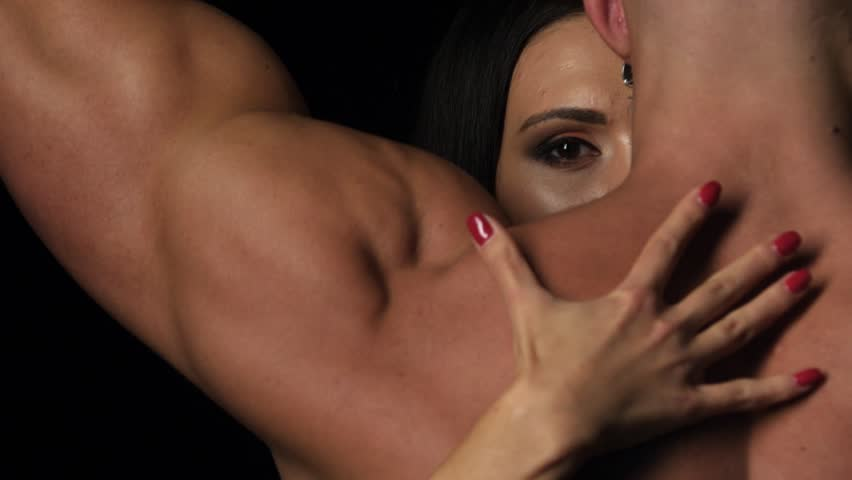 Sex - Woman's hands plunging her nails into her muscular partner's back