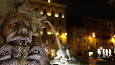 Rome, fountain in front of Pantheon. Closeup at night with street lights are reflected in the water.