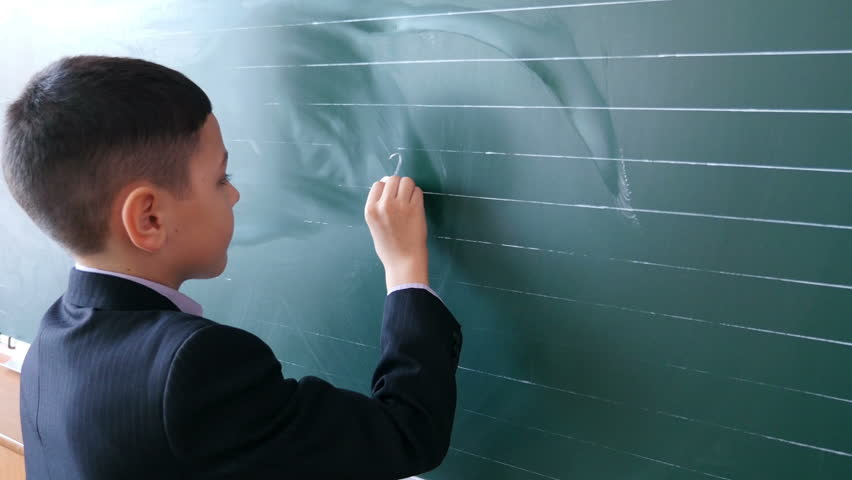 Young teacher using interactive whiteboard to display the world boy solves an example on the board at school 1 4k stock video clip gumiabroncs Gallery