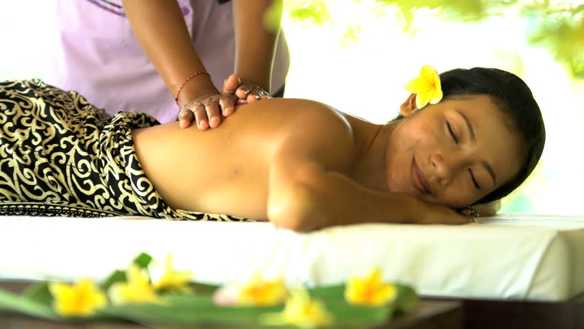 Young Asian female enjoying peaceful indulgence of Balinese aromatherapy massage for physical relaxation health and wellbeing | Shutterstock HD Video #22170403