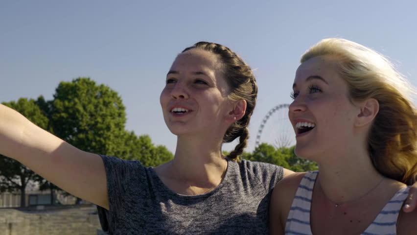 Happy Young Women Explore Paris Together By Tour Boat, Mixed Race Woman Points To Something In Distance, Blonde Woman Jokes With Her And They Laugh | Shutterstock HD Video #22180003