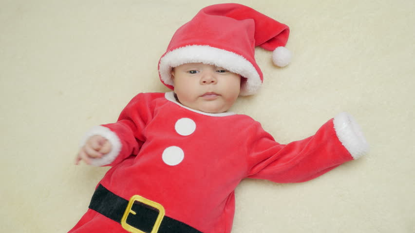 2fd75421b 4k00 27Cute 2-month-old baby boy in red Santa Claus on woolen ...