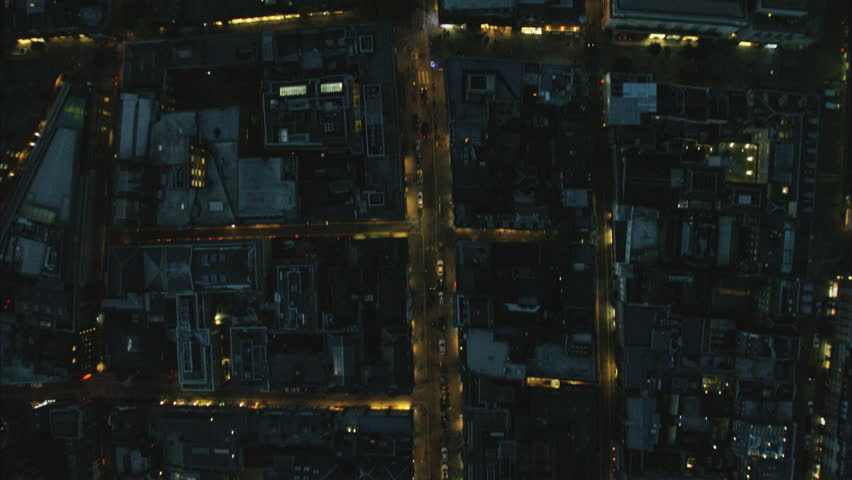 Aerial view at night of illuminated rooftops and commuter traffic in Regent Street London UK