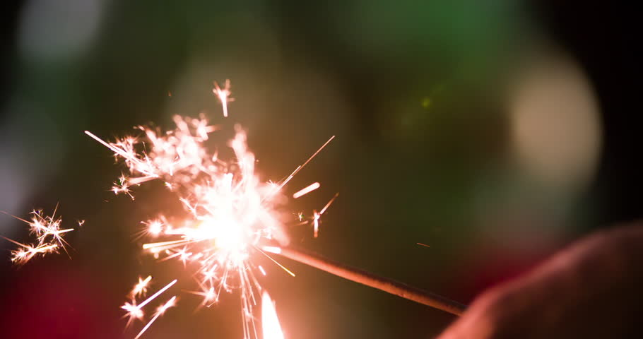 Set fire sparkler with strike a match HD close-up slow motion video background. Burning firework flames sparks. Merry Christmas and Happy New year greeting card template