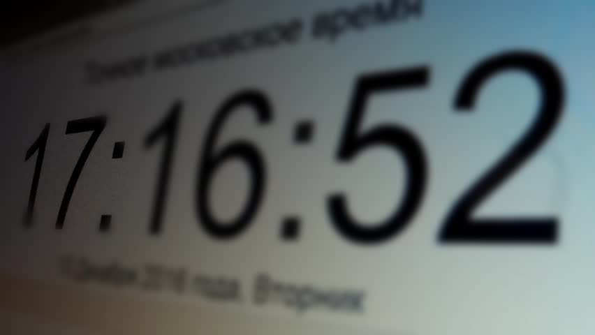 Display digital clock counts down the time ahead, the focus moves from the time digits | Shutterstock HD Video #22285432