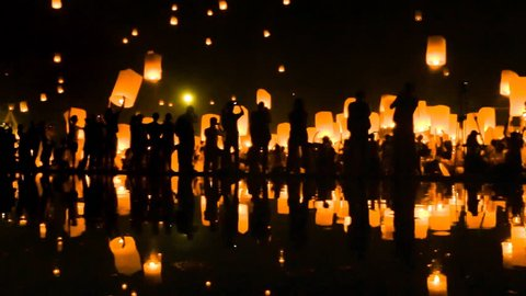 Many Sky Fire Lanterns Floating Up To The Sky In Yee Peng Lanna International 2016 And Reflection on Water Landmark Destination Travel Of Chiang Mai, Thailand (zoom out)