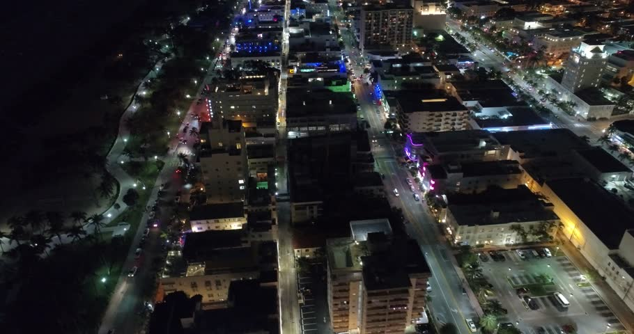 MIAMI BEACH - DECEMBER 12: Night aerial video of Miami Beach Ocean Drive which is a popular tourist destination on the beach December 12, 2016 in Miami Beach FL, USA